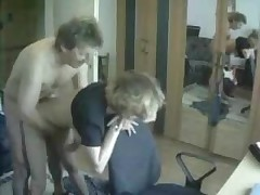 Mature Couple doing it doggie style while standing.